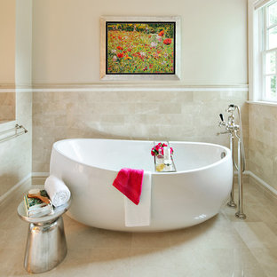 Example of a trendy beige tile and mosaic tile freestanding bathtub design in New York with marble countertops