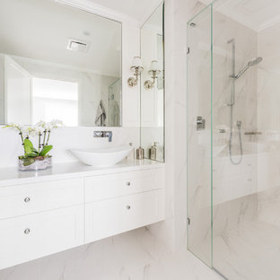 Design ideas for a transitional 3/4 bathroom in Melbourne with shaker cabinets, white cabinets, a corner shower, white walls, a vessel sink, beige floor, a hinged shower door and white benchtops.