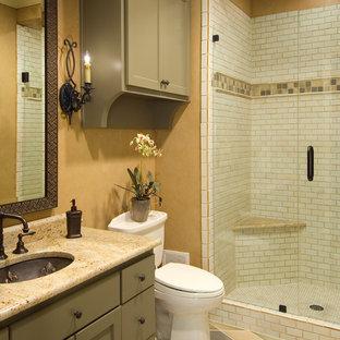 Ejemplo de cuarto de baño mediterráneo con lavabo bajoencimera, armarios con paneles empotrados, puertas de armario verdes, ducha empotrada, sanitario de una pieza, baldosas y/o azulejos blancos, baldosas y/o azulejos de cemento y paredes amarillas