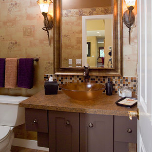 Design ideas for a medium sized mediterranean shower room in Minneapolis with shaker cabinets, brown cabinets, a two-piece toilet, brown walls, dark hardwood flooring, a vessel sink, solid surface worktops and brown floors.