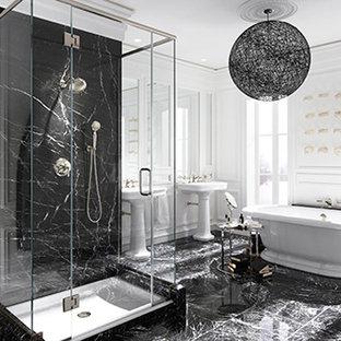 Modelo de cuarto de baño principal, contemporáneo, grande, con lavabo tipo consola, bañera exenta, paredes azules, suelo de madera oscura, ducha empotrada, baldosas y/o azulejos negros, baldosas y/o azulejos blancos, suelo negro y ducha con puerta con bisagras