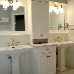 Mid-sized eclectic master bathroom in Portland Maine with shaker cabinets, white cabinets, blue walls, marble floors, a pedestal sink and granite benchtops.