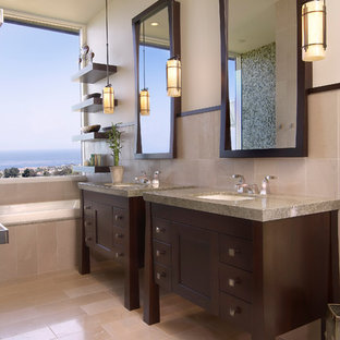 Drop-in bathtub - mid-sized beach style master blue tile, green tile and mosaic tile porcelain floor and beige floor drop-in bathtub idea in San Diego with dark wood cabinets, furniture-like cabinets, beige walls, an undermount sink and granite countertops