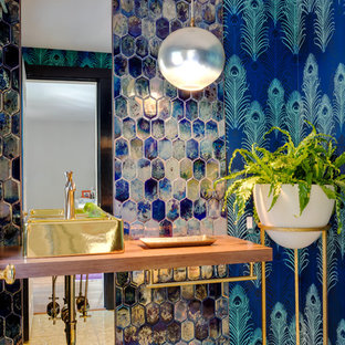 Large eclectic blue tile bathroom photo in Boston with blue walls, a vessel sink, wood countertops and brown countertops