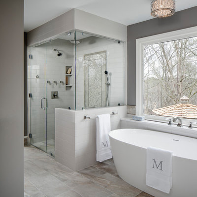 Inspiration for a large transitional master gray tile and ceramic tile porcelain tile and gray floor bathroom remodel in Atlanta with gray walls, a hinged shower door, flat-panel cabinets, gray cabinets, a two-piece toilet, an undermount sink and quartz countertops