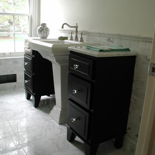 Inspiration for a mid-sized timeless 3/4 gray tile and stone tile marble floor bathroom remodel in Detroit with furniture-like cabinets, dark wood cabinets, granite countertops, white walls and a pedestal sink