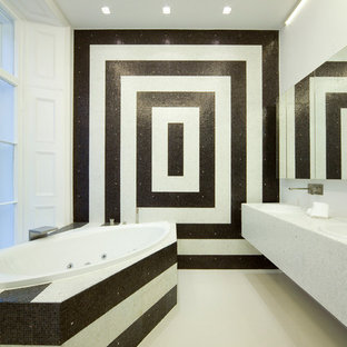 Design ideas for a contemporary bathroom in London with black and white tile.
