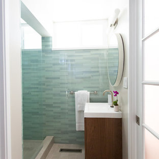 Example of a small mid-century modern 3/4 blue tile and glass tile ceramic tile alcove shower design in San Francisco with an integrated sink, flat-panel cabinets, medium tone wood cabinets and gray walls
