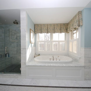Bathroom - large traditional master gray tile and stone tile marble floor and blue floor bathroom idea in New York with beaded inset cabinets, white cabinets, a two-piece toilet, blue walls, an undermount sink, marble countertops and a hinged shower door