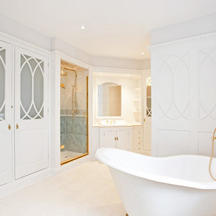 Inspiration for a large timeless bathroom remodel in London with beaded inset cabinets, white walls, white cabinets, a drop-in sink and a hinged shower door