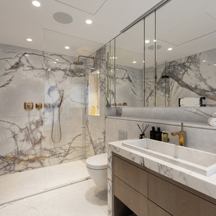 Contemporary shower room in London with flat-panel cabinets, brown cabinets, an alcove shower, a wall mounted toilet, marble tiles, grey walls, a built-in sink, marble worktops, white floors and a hinged door.