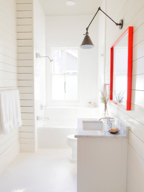 Example Of A Small Minimalist White Tile Bathroom Design In Raleigh With  White Cabinets
