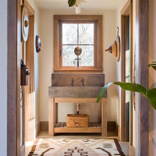 Foto de cuarto de baño principal, de estilo americano, de tamaño medio, con paredes blancas, suelo de madera oscura, puertas de armario de madera oscura, lavabo de seno grande y armarios abiertos
