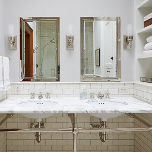 Bathroom - traditional white tile bathroom idea in Chicago with open cabinets, an undermount sink and marble countertops