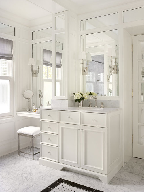 traditional bathroom idea in chicago with an undermount sink recessed panel cabinets white