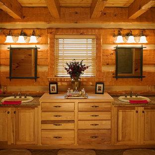 シャーロットの広いカントリー風おしゃれなマスターバスルーム (オーバーカウンターシンク、レイズドパネル扉のキャビネット、中間色木目調キャビネット、御影石の洗面台、セラミックタイル、セラミックタイルの床) の写真