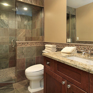 Design ideas for a large traditional 3/4 bathroom in Phoenix with shaker cabinets, dark wood cabinets, an alcove shower, a one-piece toilet, multi-coloured tile, slate, beige walls, slate floors, an undermount sink and granite benchtops.