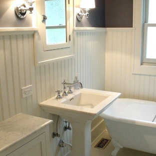 Design ideas for a mid-sized traditional 3/4 bathroom in Chicago with shaker cabinets, white cabinets, a claw-foot tub, purple walls, mosaic tile floors, a pedestal sink and solid surface benchtops.