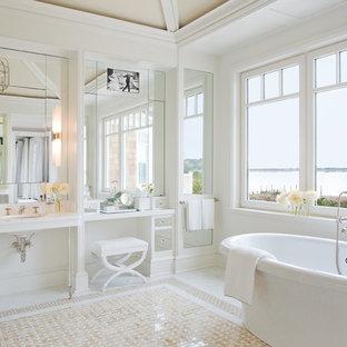 Immagine di un'ampia stanza da bagno padronale design con ante di vetro, top in granito, vasca freestanding, vasca/doccia, pareti bianche e pavimento in travertino