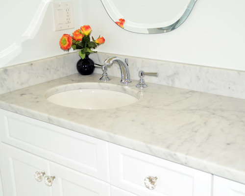 Bathroom Idea In Boston With An Undermount Sink, White Cabinets And White  Walls