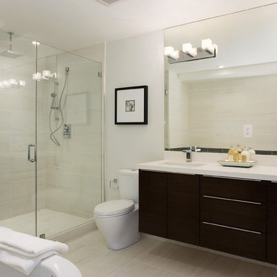 Trendy beige tile alcove shower photo in Other with an undermount sink, flat-panel cabinets and black cabinets