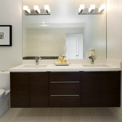 Inspiration for a contemporary beige tile bathroom remodel in Other with an undermount sink, flat-panel cabinets and dark wood cabinets