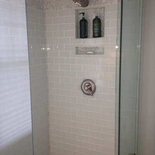 Inspiration for a transitional white tile and glass tile corner shower remodel in Chicago