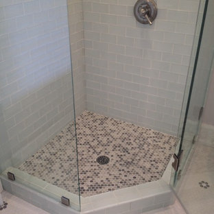 Example of a transitional white tile and glass tile corner shower design in Chicago
