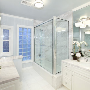White tile corner shower photo in Orange County with white cabinets and gray countertops