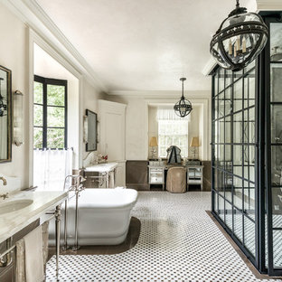 Example of an ornate mosaic tile multicolored floor freestanding bathtub design in Atlanta with beige walls and a console sink