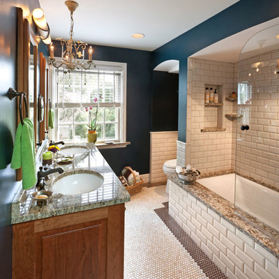 Elegant beige tile and subway tile alcove bathtub photo in Milwaukee with an undermount sink