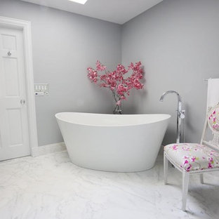 Example of a large minimalist master white tile and stone tile marble floor bathroom design in New York with beaded inset cabinets, white cabinets, a two-piece toilet, gray walls, an undermount sink and quartzite countertops