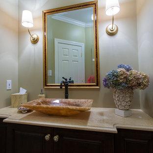 ワシントンD.C.の小さいトランジショナルスタイルのおしゃれな浴室 (ベッセル式洗面器、家具調キャビネット、濃色木目調キャビネット、珪岩の洗面台、分離型トイレ、ピンクの壁、濃色無垢フローリング) の写真