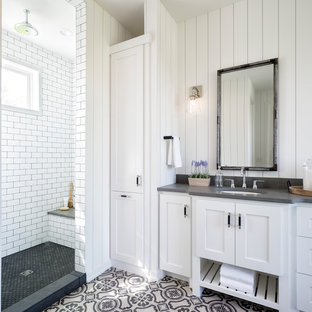 Inspiration for a country white tile and subway tile multicolored floor bathroom remodel in Minneapolis with shaker cabinets, white cabinets, white walls, an undermount sink and gray countertops