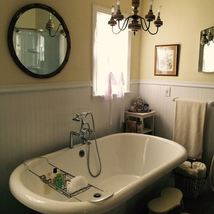 Inspiration for a mid-sized victorian master bathroom in Austin with a claw-foot tub, gray tile, ceramic floors, yellow walls, a shower/bathtub combo, an open shower, a pedestal sink and beige floor.