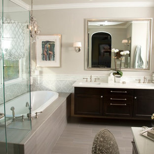 Drop-in bathtub - transitional gray tile drop-in bathtub idea in San Francisco with an undermount sink, shaker cabinets and dark wood cabinets