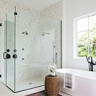 Example of a huge trendy master beige tile and marble tile ceramic floor and beige floor bathroom design in Orlando with white walls and a hinged shower door