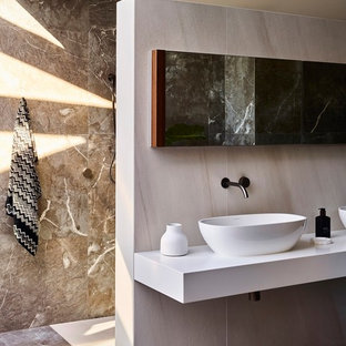 Design ideas for a mid-sized contemporary master bathroom in Brisbane with a curbless shower, beige tile, brown tile, beige walls, a vessel sink, brown floor, an open shower and white benchtops.