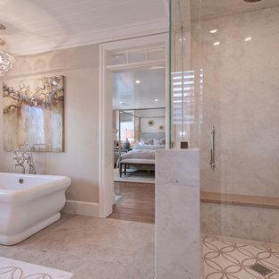 Inspiration for a timeless beige tile bathroom remodel in Orange County