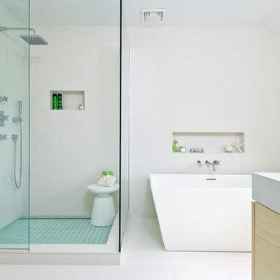 Freestanding bathtub - contemporary freestanding bathtub idea in New York with white countertops