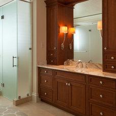 Tropical Bathroom by Kurtz Homes Naples