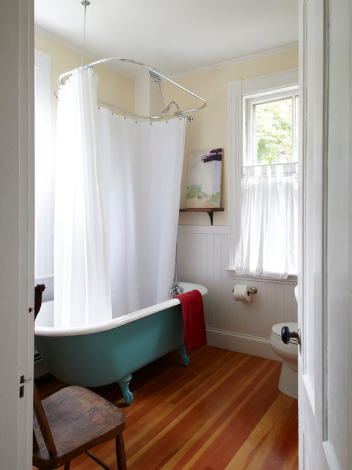 showering in a clawfoot tub. Coastal claw foot bathtub photo in San Francisco with yellow walls Clawfoot Tub Shower  Houzz