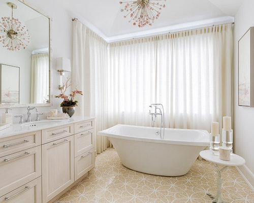 Beach Style Master Beige Floor Freestanding Bathtub Idea In Miami With  Shaker Cabinets, Beige Cabinets