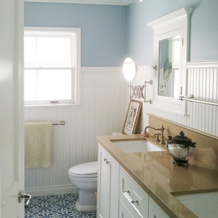 Bathroom - mid-sized beach style blue tile blue floor and ceramic floor bathroom idea in Austin with an undermount sink, shaker cabinets, white cabinets, a one-piece toilet, blue walls, engineered quartz countertops and brown countertops