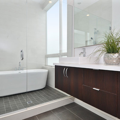 Trendy freestanding bathtub photo in Seattle with white countertops