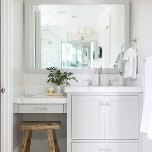 Mid-sized transitional master porcelain tile and white floor bathroom photo in Orange County with shaker cabinets, gray cabinets, a two-piece toilet, gray walls, an undermount sink and soapstone countertops