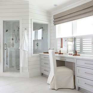 Inspiration for a beach style master gray tile painted wood floor corner shower remodel in Charleston with gray cabinets, white walls and shaker cabinets