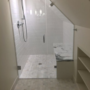 Small beach style 3/4 white tile and ceramic tile marble floor and white floor walk-in shower photo in Seattle with open cabinets, white cabinets, a wall-mount toilet, white walls, a wall-mount sink, marble countertops, a hinged shower door and white countertops