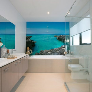 Beachside, picture glass splash-back to bath in Ensuite