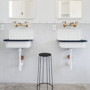 Inspiration for a country white tile concrete floor and gray floor bathroom remodel in Austin with white walls and a wall-mount sink